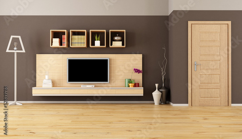 minimalist living room with cabinet shelves and  tv