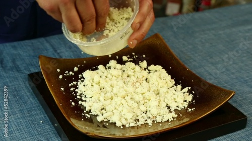 Pouring Feta Cheese