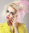Bright Blonde with Shaggy Hair and Blue Eye Makeup. Glam