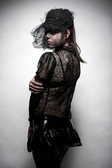 Junge Frau mit Lack-Minirock und  Haute Couture Spitzentop