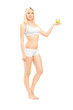 Beautiful woman in white cotton underwear holding a green apple