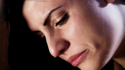 Closeup of sad beautiful woman crying