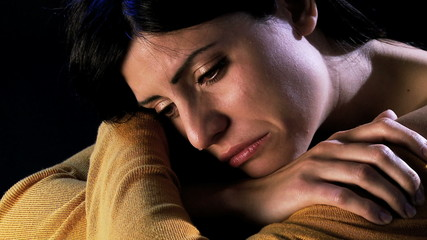 Sad woman crying for loss of beloved person