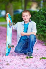 happy teenage boy portrait, in spring park