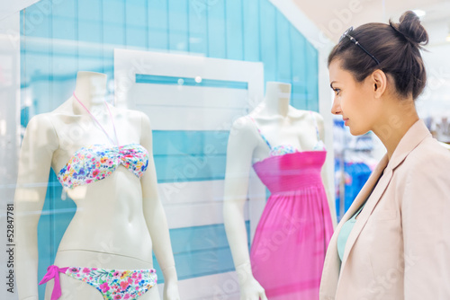 Shopping time, woman at mall looking at window