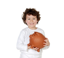 Little boy with his a big piggybank