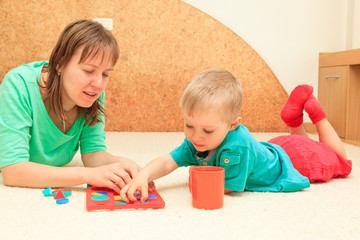 little boy learning shapes with mother