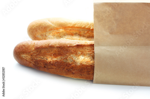 Fresh bread in paper eco bag.
