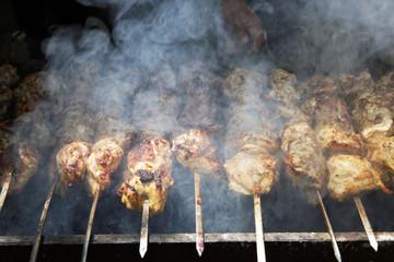 Shish kebab on the grill with smoke.