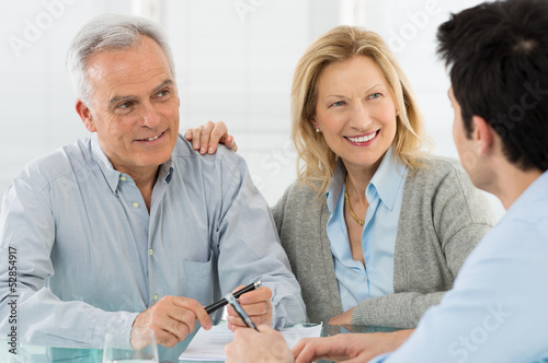 Senior Couple Talking With A Consultant - 52854917