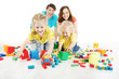 Happy family. Parents with two kids playing blocks toys