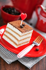 Slice of tiramisu cake, selective focus