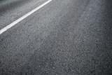 Fototapety Detail of asphalt road with white line