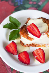 pancake with sour cream and rich strawberry, top view