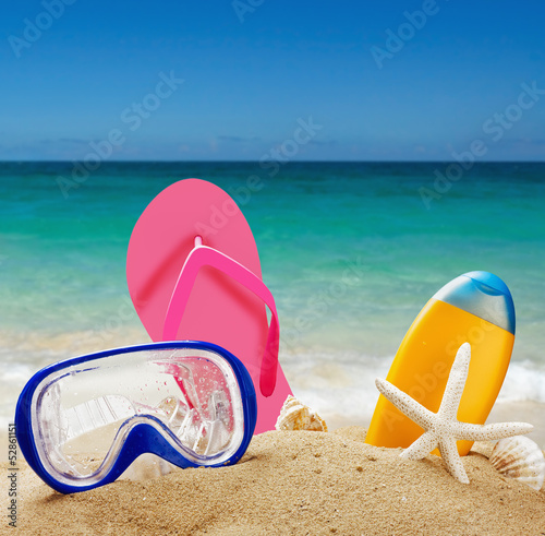 beach accessories in the sand against the sea landscape