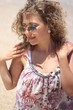 Curly attractive woman having fun at the beach