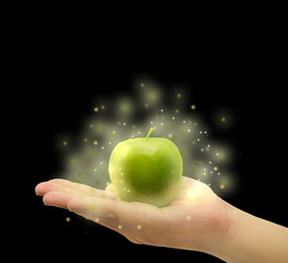 Magical apple on the palm in isolated background