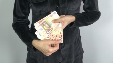 black shirt woman offering banknotes