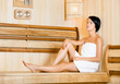 Half-naked girl relaxing in sauna