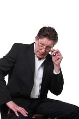 business skeptisch mann