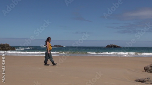 pregnant woman walking at beach