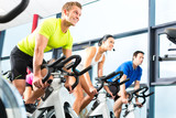 Fototapety group doing sport Spinning in the gym for fitness