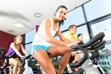group doing sport Spinning in the gym for fitness