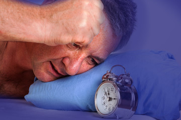 Man can not sleep and looked at the alarm clock