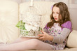 fashion little girl sitting on sofa
