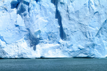ice falling off of a glacier in Patagonia, South America.