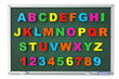 Alphabet Toy magnetic letters over blackboard