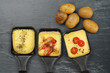 Raclette trays and potatoes - 52869301
