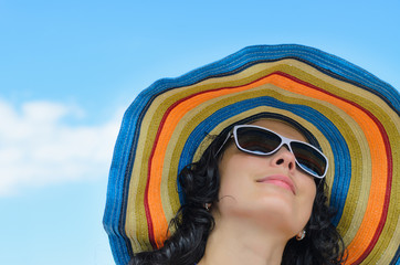 Beautiful woman in a wide brimmed sunhat