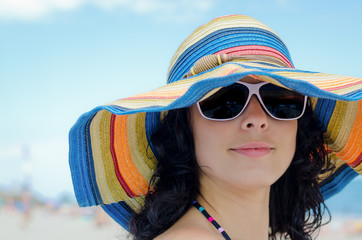 Pretty woman wearing a colourful sunhat