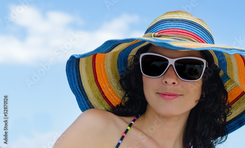 Beautiful woman in a summer sunhat