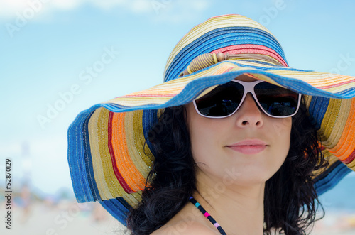Pretty woman wearing a colourful sunhat