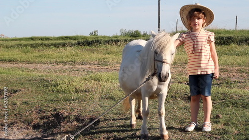 little girl with cowboy hat and pony horse