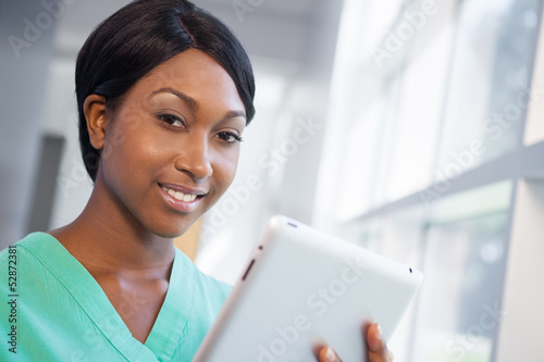 Nurse with tablet computer