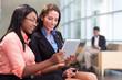 Two businesswomen in lobby