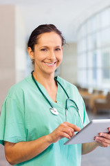Nurse with computer tablet