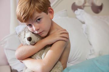 Young boy feeling sad.