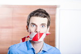 Businessman in silence with red warning tape