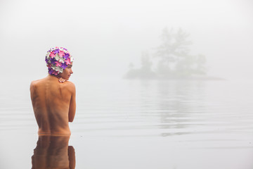 Women bathing in lake