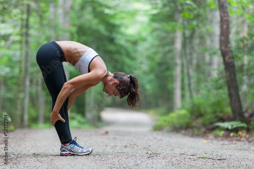 Middle aged woman stretching