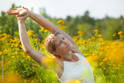woman stretching in ragweed flowers