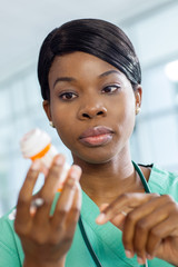 Nurse examines prescription bottle