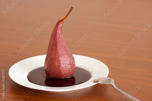 Pear poached in red wine.