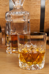 glass of whiskey and barrel