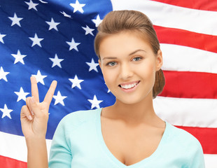 young woman showing victory or peace sign