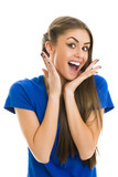 Excited surprised lady in blue T-shirt gesturing with her hands
